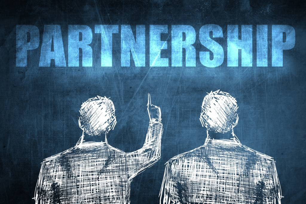 EffectiveCommPartners back of 2 men in pencil one pointing to word partnership above them 1024x683 - Effective Communication With Your Partners