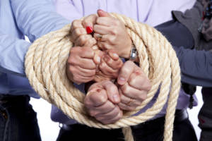 MistakesMakeInPartnership group of hands bound together by rope 300x200 - Eleven Mistakes You Are Making In Your Business Partnership