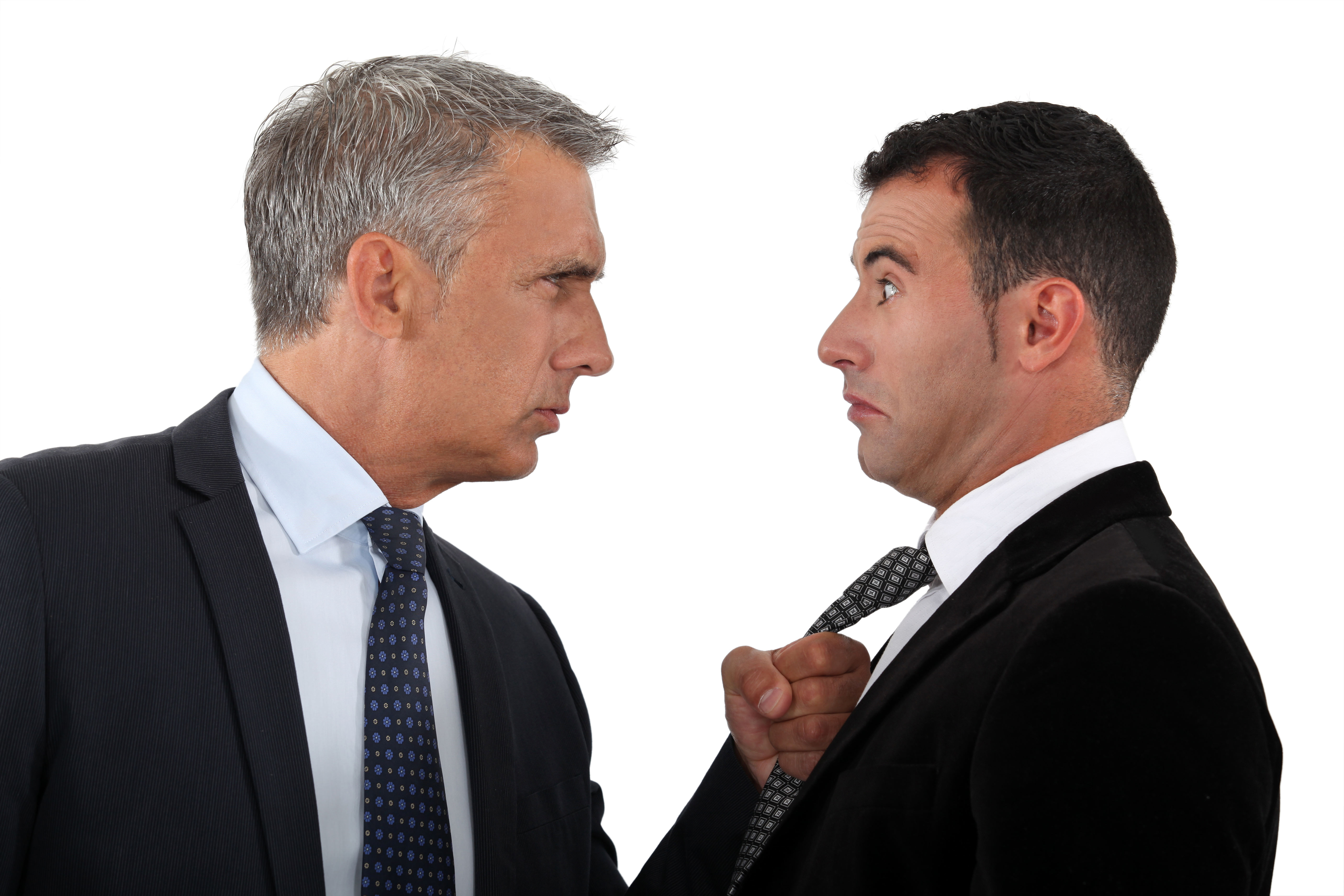 CoPressureImpactPartnership2 men facing each other with one grabbing the other by the tie - Company Pressures and the Impact on Business Partnerships