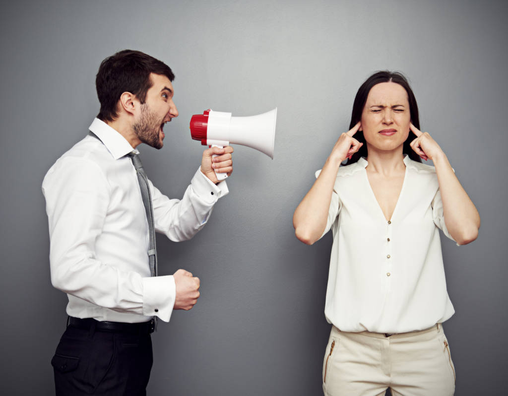 Communicating Effectively man screaming into megaphone women with hands in ears 1024x798 - Customer Service Excuses that Turn Customers Into Enemies