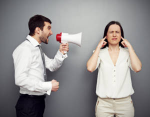 Communicating Effectively man screaming into megaphone women with hands in ears 300x234 - Communicating Effectively: Focus on Intentions When Talk Gets Ugly