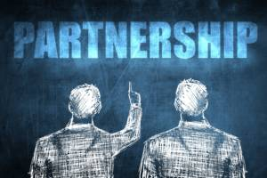 EffectiveCommPartners back of 2 men in pencil one pointing to word partnership above them 300x200 - Effective Communication With Your Partners