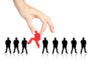 GreatLeadersKnowHowandWhotoHire row of business people in black with hand selecting the one person colored red 300x200 - Great Leaders Know How and Who to Hire
